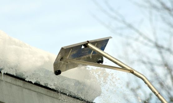 snow being removed from the roof