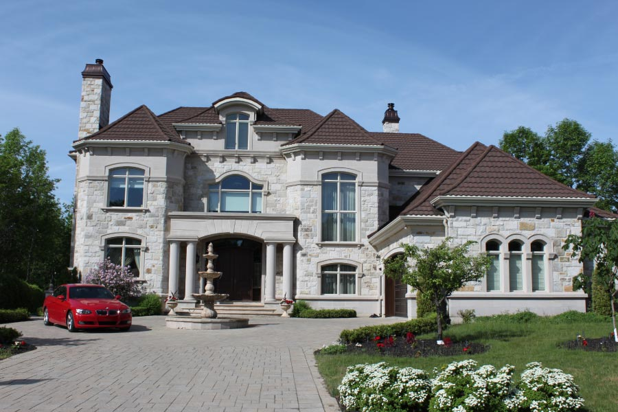 Large luxury house, fountain and paved entrance